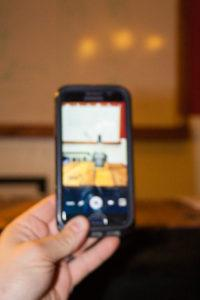 A Smartphone Taking a Picture in Portrait Orientation
